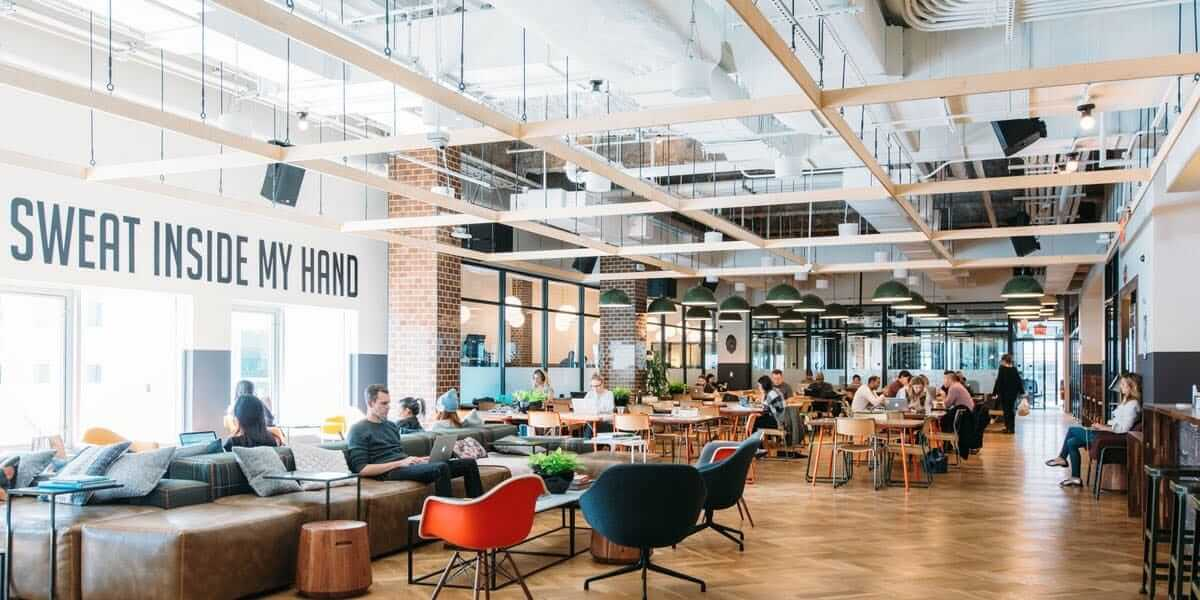 Modern co-working office space with workers on laptops