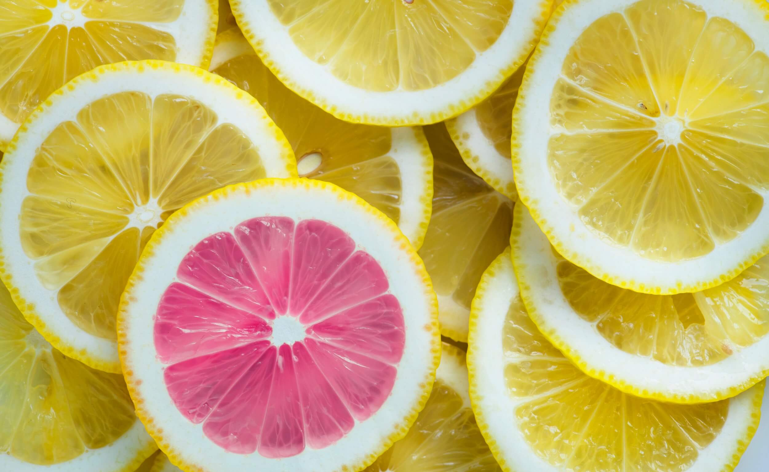 Yellow and pink lemon slices