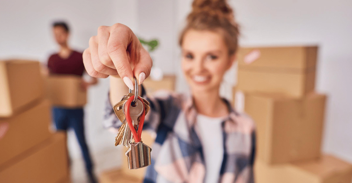 Woman holding keys to her new home
